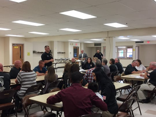 Chambersburg Police Cpl. Matt Biestch talks to participants of the first Chambersburg Police Academy at their graduation ceremony Aug. 24.
