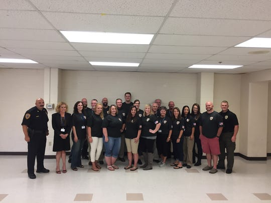 Chambersburg Police Cpl. Matt Biestch talks to participants of the first Chambersburg Citizen's Police Academy at their graduation ceremony Aug. 24.