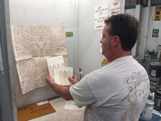 York Wallcoverings employee Eric Anderson matches colors