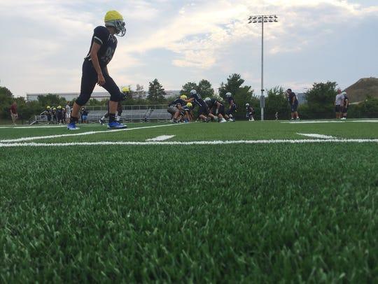 John Jay High School football players practice on the