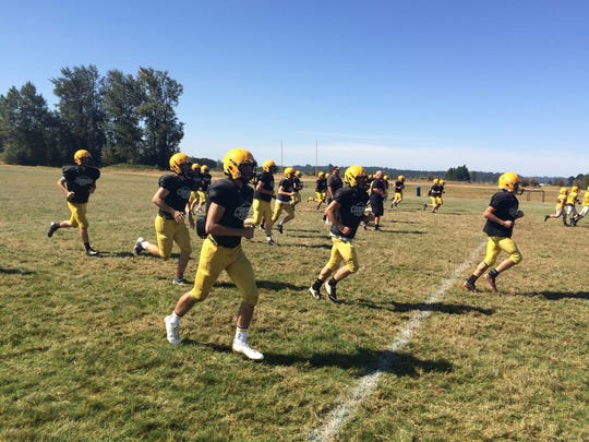 Cascade's football team warms up before practice Aug.