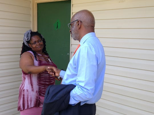 Interim FAMU President Larry Robinson, right, speaks with parent Nicole Gibson of Miami, at Palmetto North Apartments on Friday, Aug. 25, 2017.