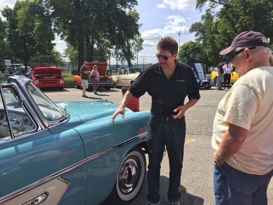 Bill Smith talks about his 1956 Plymouth Belvedere convertible with Paul Flanagan of Croswell at the Hot Wheels Weekend in Marysville City Park in 2017.