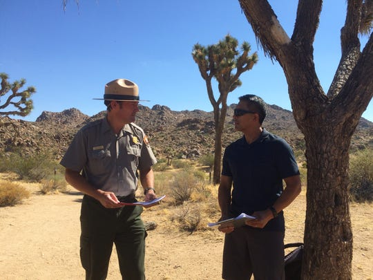 Joshua Tree National Park Superintendent David Smith and Gilbert Orbeso, father of missing hiker Joseph Orbeso, speak during a press conference at the Maze Loop trailhead on Saturday, Aug. 26, 2017. The trailhead is where officials believe Joseph Orbeso and Rachel Nguyen started out on a hike on July 27, 2017. The couple hasn't been seen since about 6:45 a.m. that day.