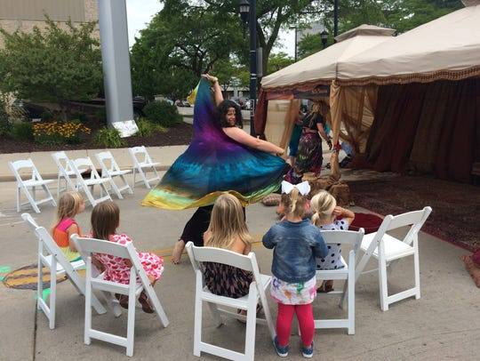 A dancer entertains children at last year's Artstreet.