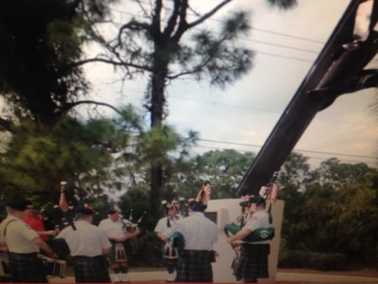 FDNY Emerald Society bagpipers pay tribute to the Palm