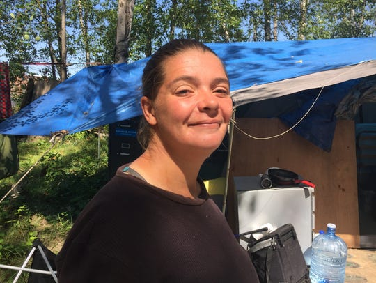 Ashley Baker, 32, who is homeless and lives in a tent
