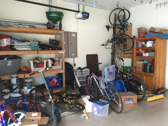 After three years of tossing everything, from bikes and scooters, assorted sports equipment, balls galore, instant fire logs, sneakers and who knows what else all over the place, thisgarage was out of control. Forget the fact that the cars didn't fit in the garage —entering the house from the garage had become impossible.
