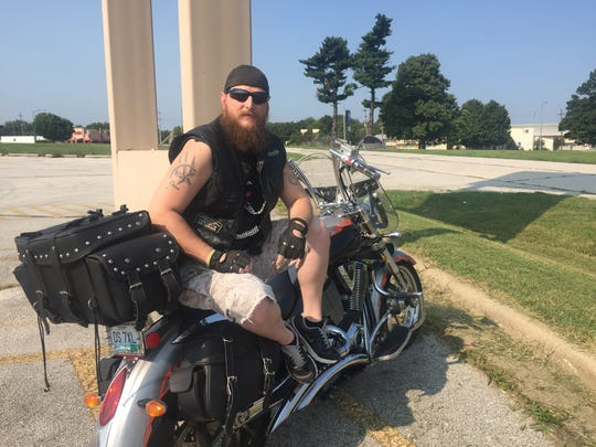 Danny Hall, of Springfield, rode his motorcycle to the old KMart parking lot to see the presidential motorcade and show his support for Trump.