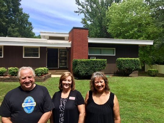 Sam Tune, Crye-Leike Realtor Judy G. Smith and Maria Tune, outside the mid-century modern home Sam grew up in.