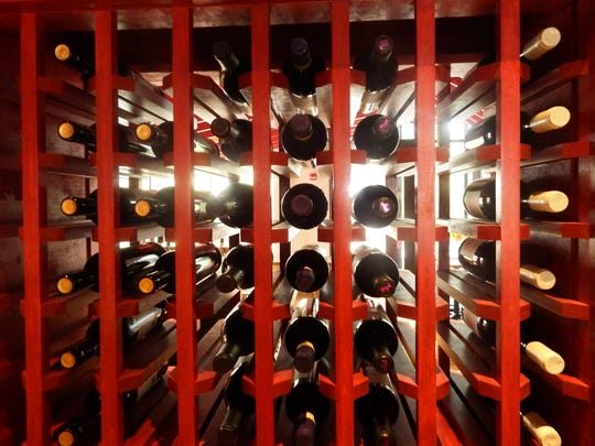 The wine rack inside Maggie's Farm Wood-Fired Pizza