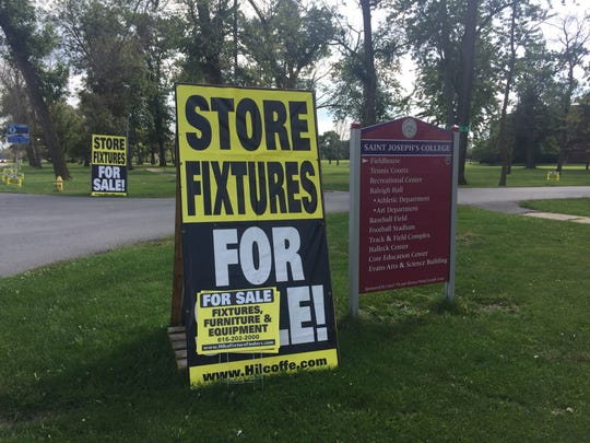 Liquidation signs line Drexel Road, the entrance to Saint Joseph's College in Rensselaer. The college, which closed after the 2016-17 school year, is selling nearly everything as it continues the process of shuttering the campus.