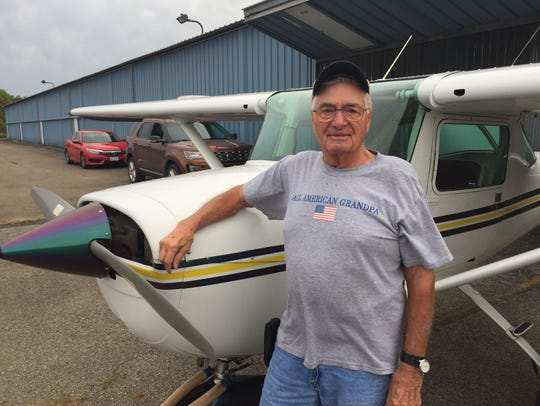 "Alan ""Sonny"" Dupler stands beside his Cessna airplane"