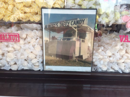 Old picture of a McMeen's Taffy stand.