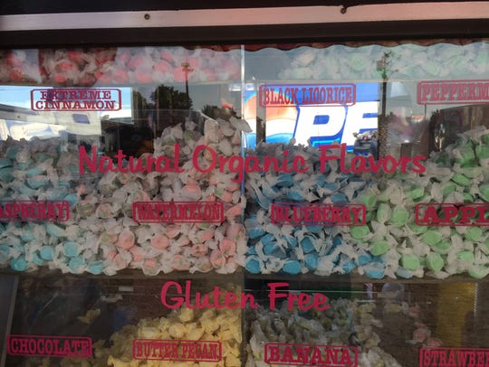 Assorted flavors of taffy in the window of McMeen's
