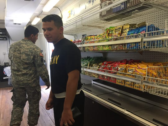 Sgt. Derek Garcia and Sgt. Terryll Brunson shop around in the Mobile Field Exchange commissary at the Corpus Christi National Guard armory.