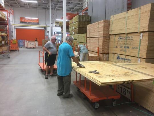 Pat Tydor of Indialantic (far right) was at Home Depot
