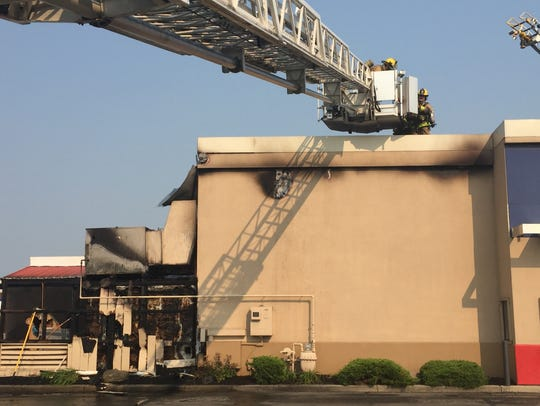 Muncie firefighters Monday afternoon  reach the roof