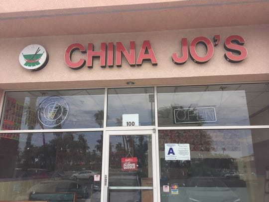 """A closed sign at China Jo's in Indio around lunchtime. The restaurant closed last week """"due to business failure."""""""