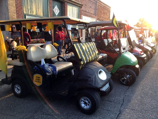 Golf carts are lined up along Main Street in Slater,