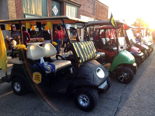 Golf carts are lined up along Main Street in Slater, awaiting judging as part of RVTV's Cy-Hawk street party on Tuesday, Sept. 5, 2017.