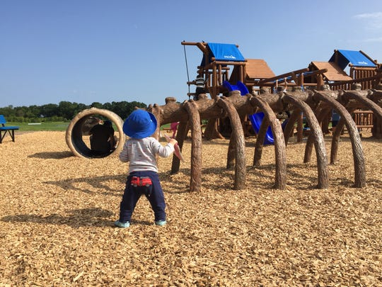 Reporter Victoria Freile's son Joe explores Jack's Place playground at Penfield's Rothfuss Park.