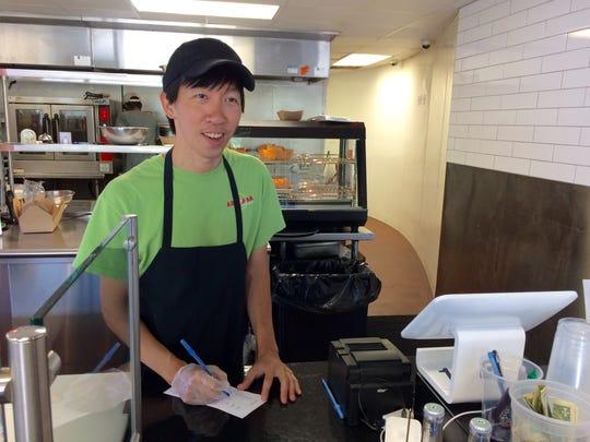 Nam Vu working the counter at Arepana.