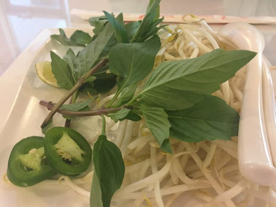Garnishes for the pho at the new vPho: A Taste of Vietnam restaurant near Newark were fresh and plentiful.