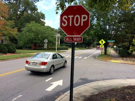 """New """"All Way"""" stop signs on Kimberly Avenue at its intersection with Country Club and Farrwood have some motorists confused, as the roads are offset."""