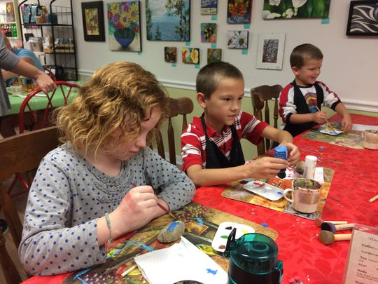 Kids gather after school at Macy Place open art studio in Fond du Lac to paint rocks for the Fondy Rocks!!! movement.  From left are Ava Chamberlain, 8, Joey Lewis, 9, and Mark Schmidt, 4.