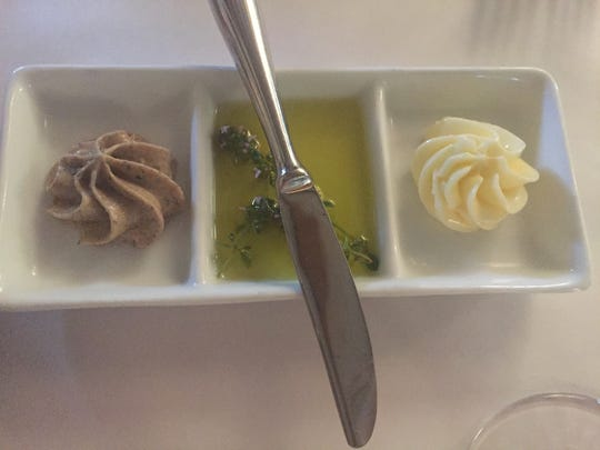 Accompaniments for the bread at Lagniappe Brasserie,  17001 W. Greenfield Ave. in New Berlin, include chicken liver mousse, herbed olive oil and butter.
