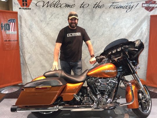 John Bentley poses with the 2014 Street Glide Special he chose at Harley-Davidson of Wausau in Rothschild.