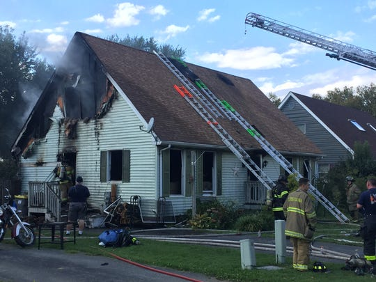 Multiple fire crews were called to the Laurel Hills development near Elsmere Friday afternoon for a house fire.
