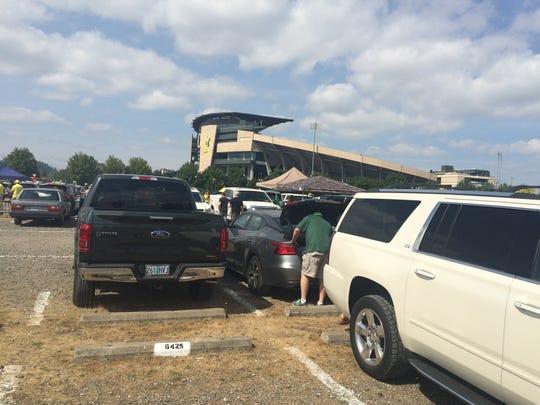 Fans enjoy tailigating Saturday prior to the Oregon-Nebraska game at Autzen Stadium.