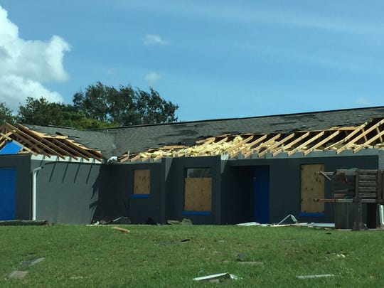 Damage in Mims from a tornado spun up by Hurricane