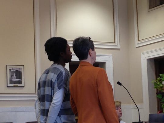 Johntae Dearmond, at left, standing next to his attorney,