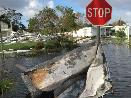Aluminum siding and roofing was strewn around the Holiday Manor mobile home park on Monday, the day after Hurricane Irma struck Southwest Florida.