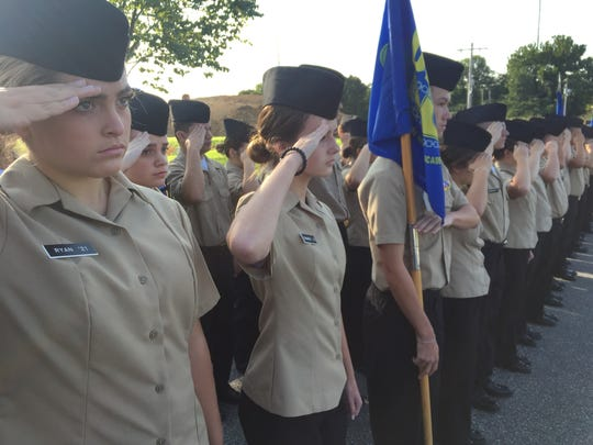 Cadets at the Delaware Military Academy salute during the school's 14th 9/11 remembrance ceremony.