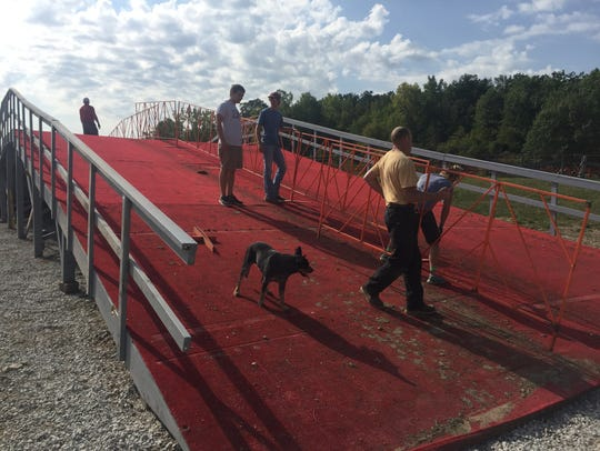 Volunteers help construct the 90-feet-long flyover