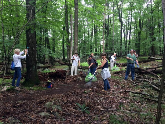 Volunteers prepare the Lake Hopatcong Trail which opens