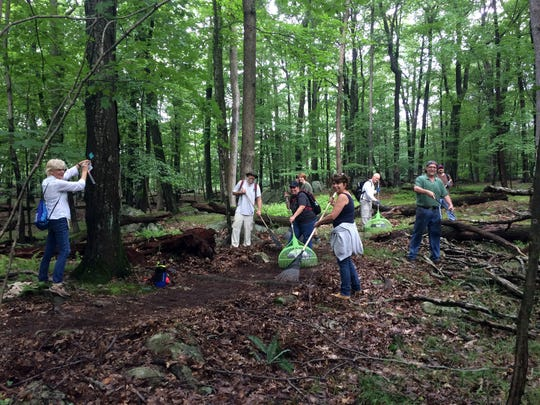 Volunteers prepare the Lake Hopatcong Trail which opens Sept. 23.
