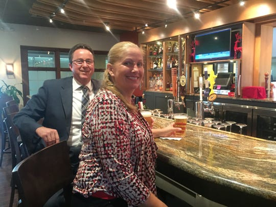 Dean R. Sampson of Mount Laurel, general manager of the DoubleTree Suites by Hilton, and Redz, enjoys a craft beer with Food and Beverage Manager Deborah O'Connor of Mount Laurel. Redz is installing a new tap system to accommodate a rotation of local and regional craft beers.