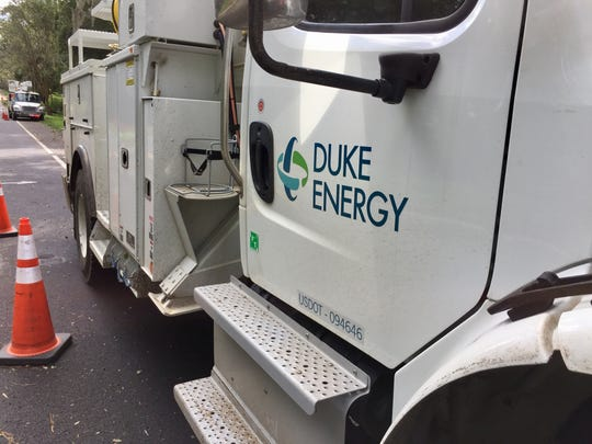 Duke Energy crews repair lines Tuesday off U.S. Highway 90 east near the Jefferson/Leon County line.