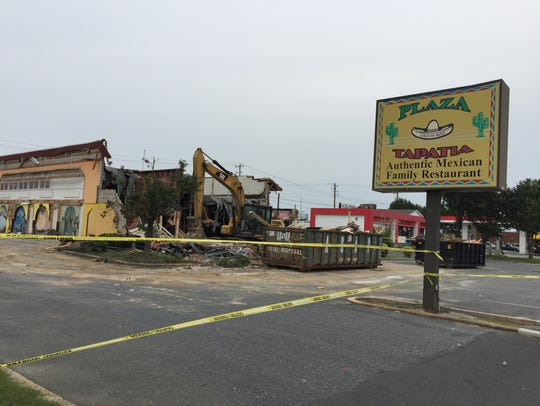 Plaza Tapatia is torn down Monday, Sept. 11, to make