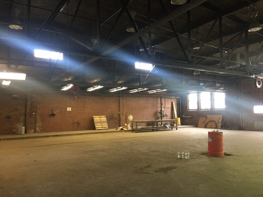 Try to imagine this garage at Mass Ave.'s old Coca-Cola bottling plant as a grand food hall. Hendricks Commercial Property plans to make that happen by mid-2019. Exposed ceilings and red brick walls would remain.