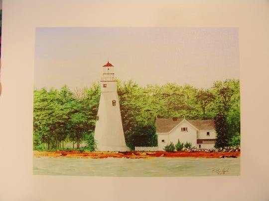 Ernie Galajda's painting of a lighthouse in Marblehead.