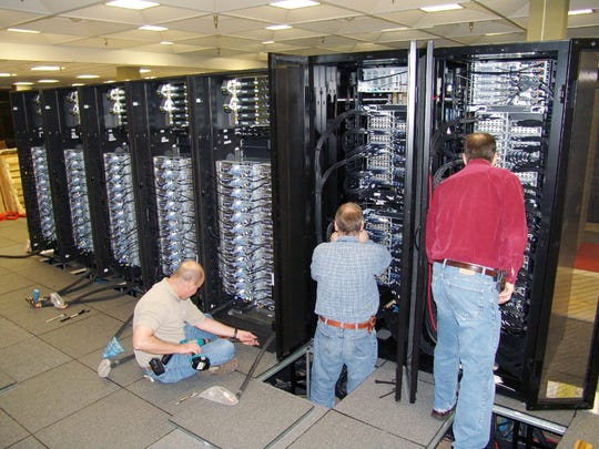 The process of installing Bluefire included connecting coolant hoses through the computer room floor and attaching cables (96 per cabinet) to the InfiniBand interconnect system that provides parallel processing service for Bluefire nodes.