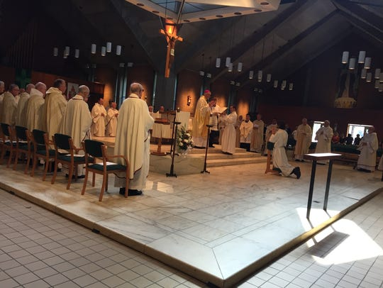 The ordination of Michael Carter, who became a priest
