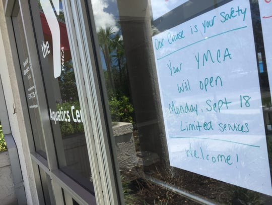 A sign posted on the Greater YMCA door indicates the