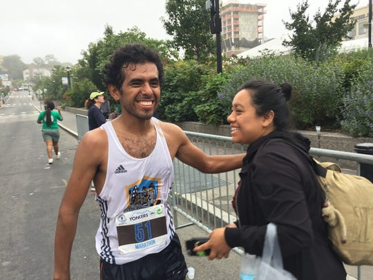 Antonio Herrera of New York City is congratulated after winning the Yonkers Marathon in 2:43.42. Photo from September 16, 2017.